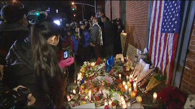 Vigil for murdered NYPD officers; US race relations remain on edge
