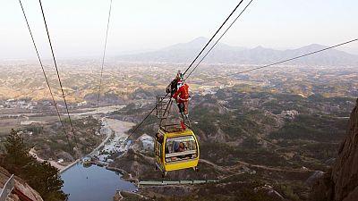 Acrobatic Santa delivers presents in China