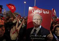 Supporters of new Tunisian president celebrate his victory