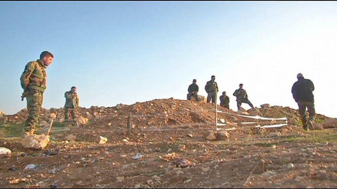 Yezidiler yakınlarını toplu mezarlarda arıyor