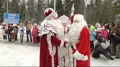Father Christmases meet at Russia-Finland border