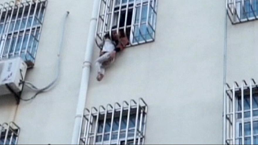 Dangling Chinese boy rescued