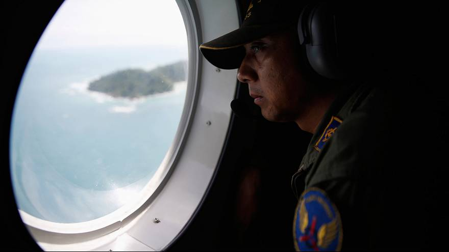 Grim task of retrieving bodies after wreckage of missing AirAsia plane found