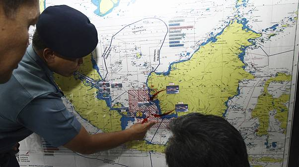 Scenes of distress in Indonesia as bodies and wreckage from missing plane found