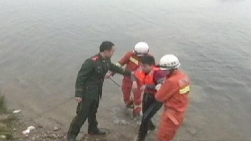 China: Driver rescued after driving car into river