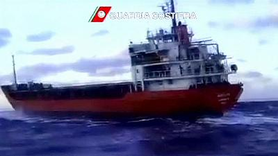 Cargo ship with 700 migrants on board and no crew docks in Italy