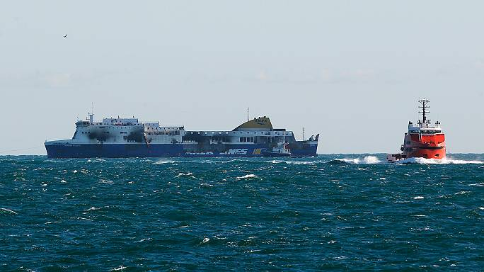 Burned-out Norman Atlantic ferry waits to moor at Italian port Brindisi