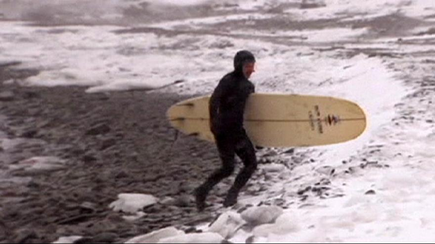 Russia's winter surfers brave freezing temperatures on the waves
