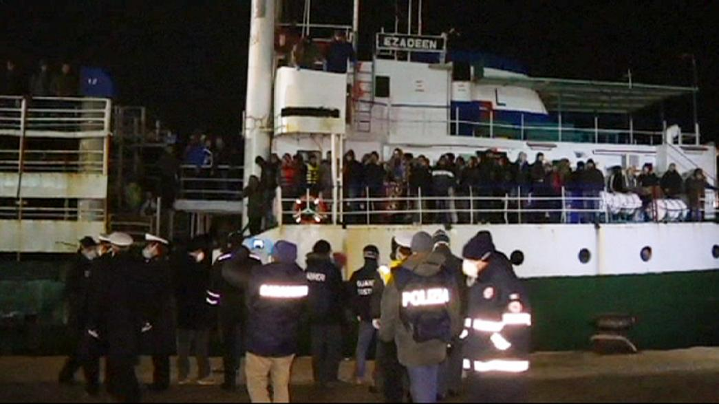 Italy: Abandoned cargo ship full of migrants is safely towed to port