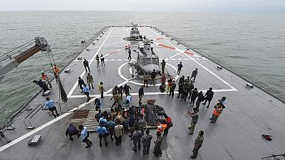 Indonesia claims breakthrough in AirAsia search after large objects found