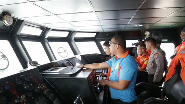 Navy finds what may be AirAsia plane's tail containing black boxes