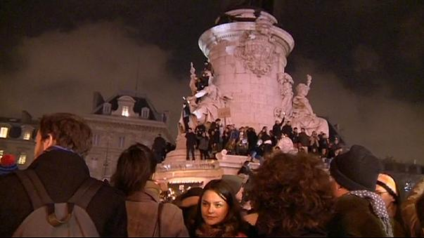 Tens of thousands hold a vigil for the victims of the Paris terror attack