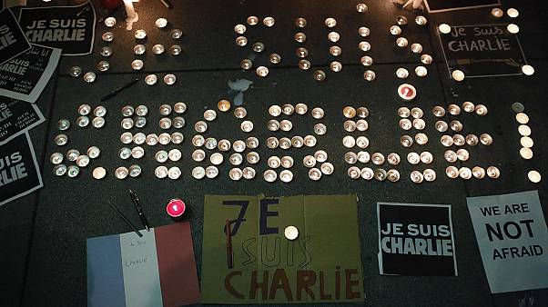Cities worldwide show their support for murdered French satirists