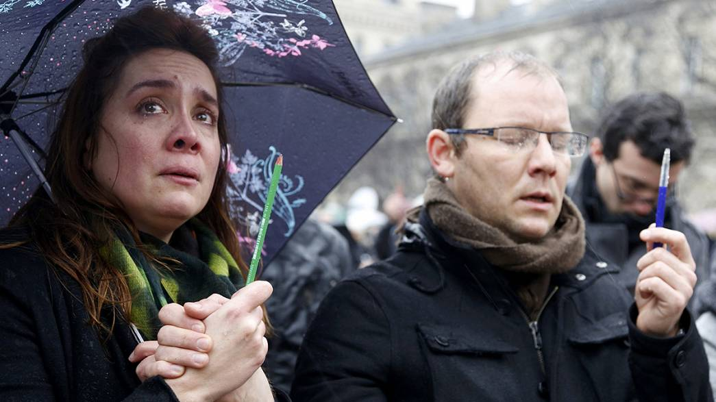 Francois Hollande leads a minute of silence for a nation in mourning