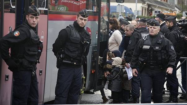 French residents caught up in siege lockdown face anxious wait for news