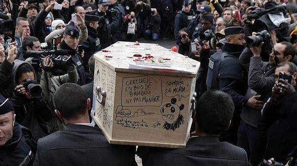 Tears - and cartoons - at Charlie Hebdo victims' funerals