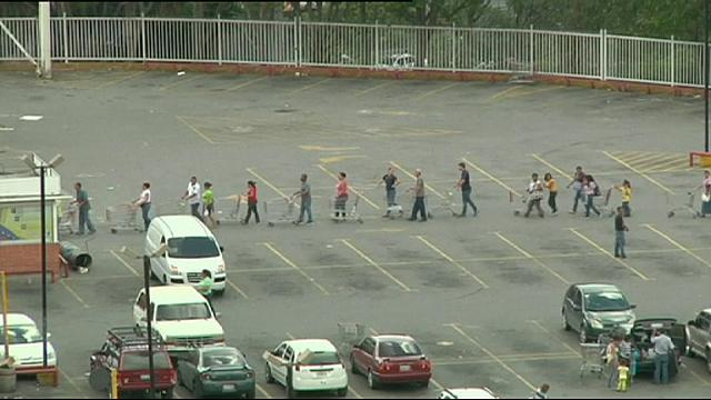 Queues outside Venezuelan supermarkets amid shortages