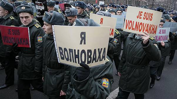 Ukrainians remember 13 killed in Volnovakha