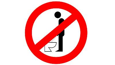 German men 'can use toilet while standing', judge rules