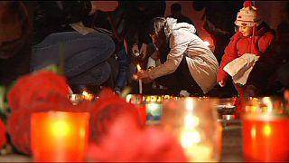 کی یف سوگوار کشته شدگان در ماریوپل