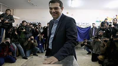Greece election: Tsipras promises 'return to democracy'