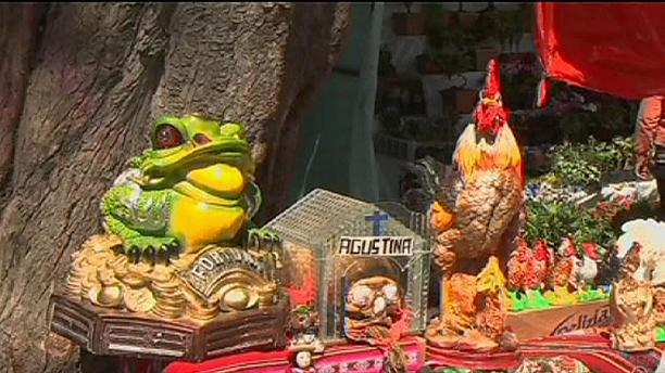 Bolivians celebrate Ekeko, god of abundance, at Alasitas Fair