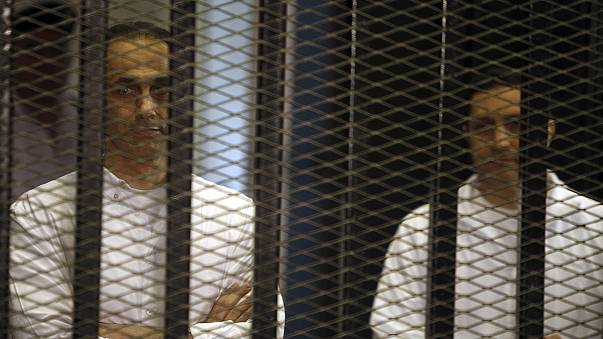 Mubarak sons released from jail in Egypt pending retrial