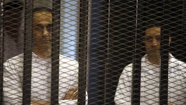 Mubarak sons released from jail in Egypt pending retrial