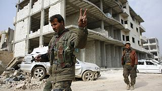Syrian Kurds return to Kobani to city 'destroyed' by fighting