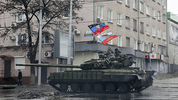 Heavy shelling in eastern Ukraine forces civilians to flee