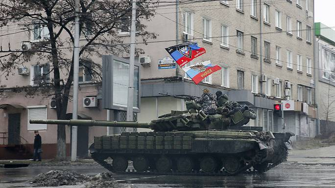 Heavy shelling in eastern Ukraine forces civilians to flee