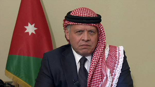 King Abdullah says killing will unite Jordanians but faces protests at home