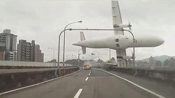 Taiwanese plane clips highway and plunges into river: ten killed