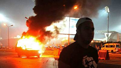 At least 22 dead in clashes outside Cairo football stadium