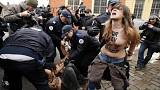 [Pictures] FEMEN's topless protest as Strauss-Kahn arrives for trial over alleged pimping