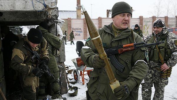 Peace talks in Minsk get underway as fighting in Ukraine continues