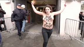 Bare-chested Femen protesters jump on DSK's car at trial