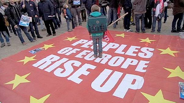 Demonstrators in Athens and Brussels tell EU finance ministers  - no more austerity!