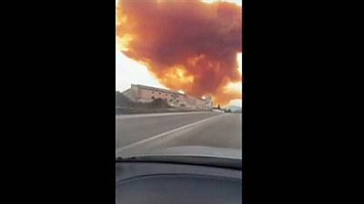 Toxic orange cloud forces locals indoors after chemical explosion in Spain