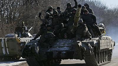 Ukraine president confirms pull out of troops from rebel-held city