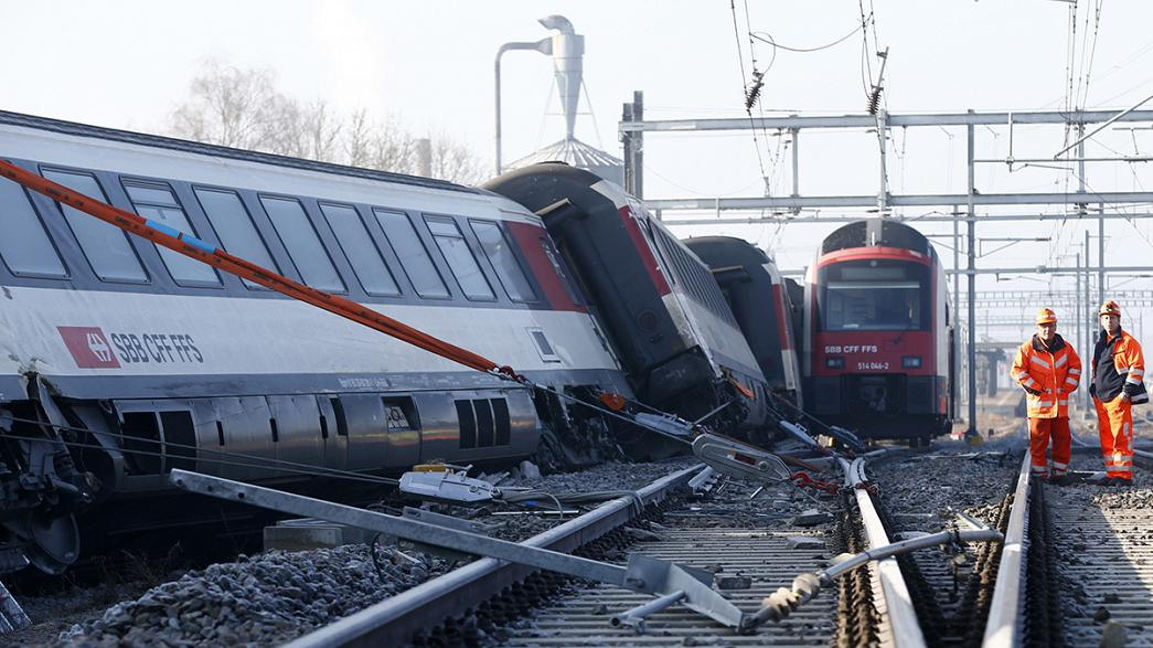 Swiss train collision injures 'scores of people'