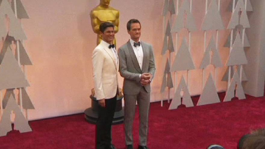 Stars dazzle on the red carpet at the 87th Academy Awards