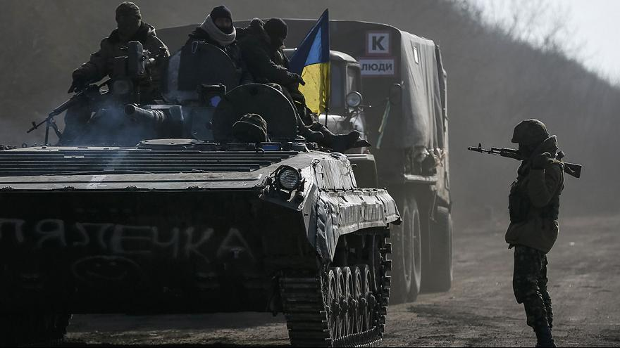 Kyiv says it can not withdraw heavy weapons while still under attack