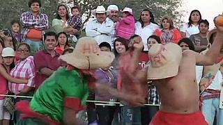 Hundreds join Mexican orange throwing festival