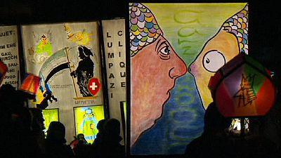 Carnival night procession illuminates the streets of Basel