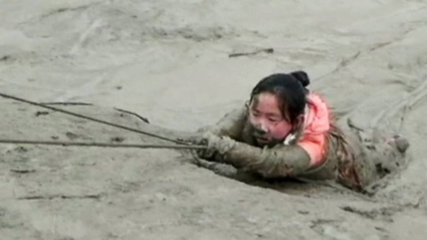 Firefighters pull girl out of mire in China
