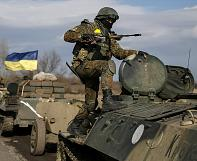 Both sides pull back heavy weapons in eastern Ukraine but mistrust remains