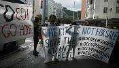 Protesters clash with IOC over Rio golf course
