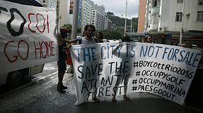 web: Protesters clash with IOC over Rio golf course