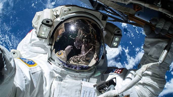 Astronauts go on spacewalk for new work on ISS